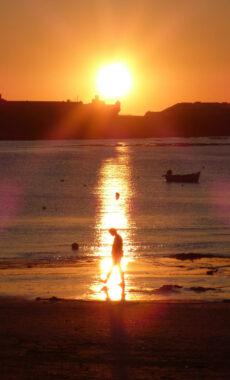Spain andalucia cadiz city seafront man caleta sunset flare