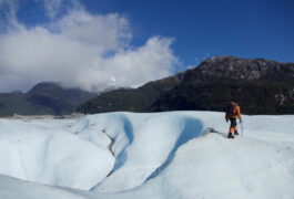 Chile patagonia carretera austral exploradores glacier guide walking onto left hand edge of image