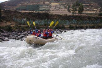 Peru sacred valley group rafting oars aloft