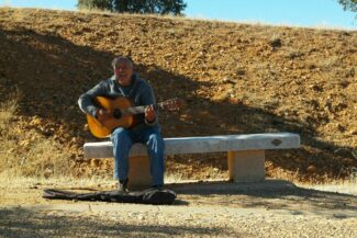 Spain camino de santiago guitar player astorga