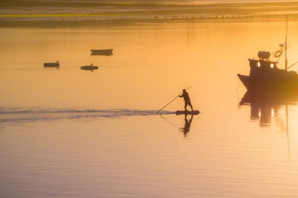 Chile chiloe fisherman sunset adobe stock