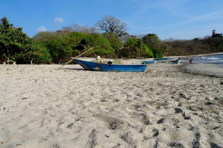 Costa rica nicoya peninsula fishing boats on sands of san juanillo beach copyright alison thomas