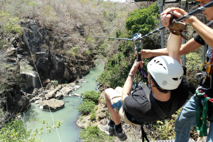 Costa rica tenorio rio perdido canopy tour setting off on zip line