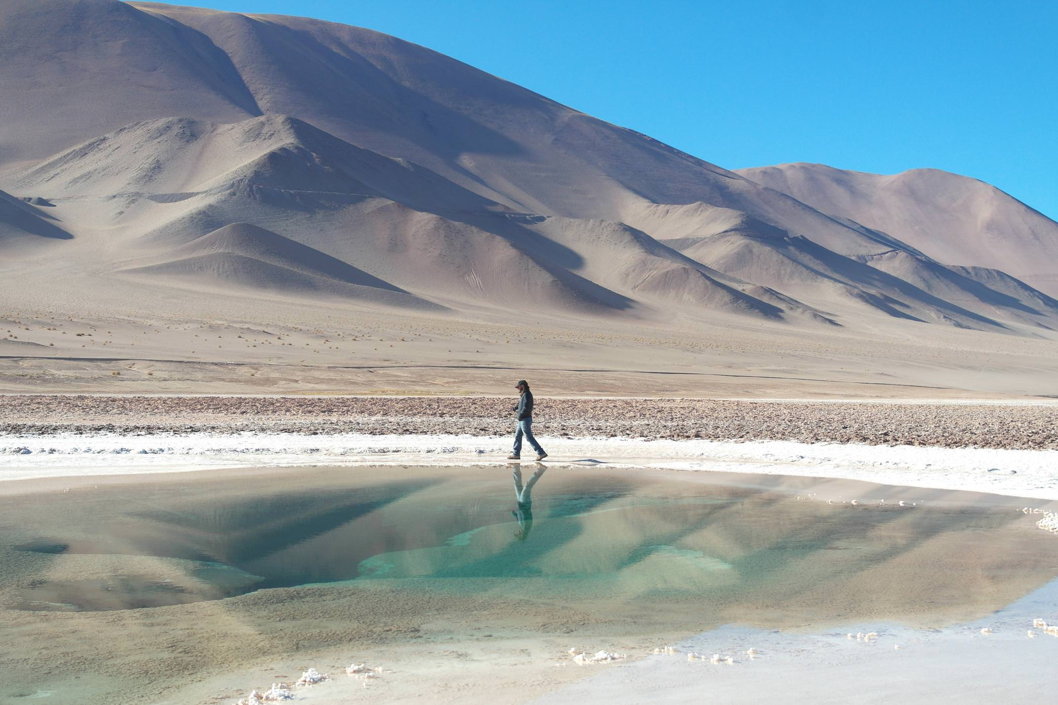 Argentina salta man walking round ojos del mar