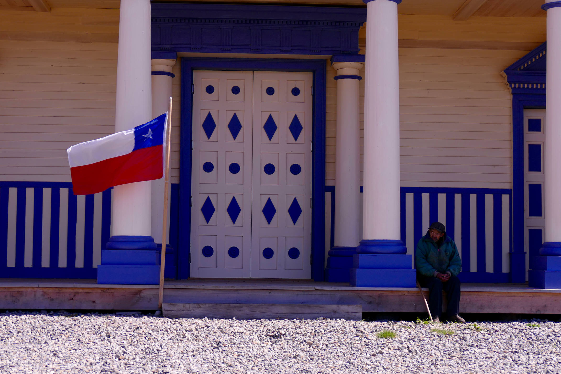 Chile chiloe man in front of church