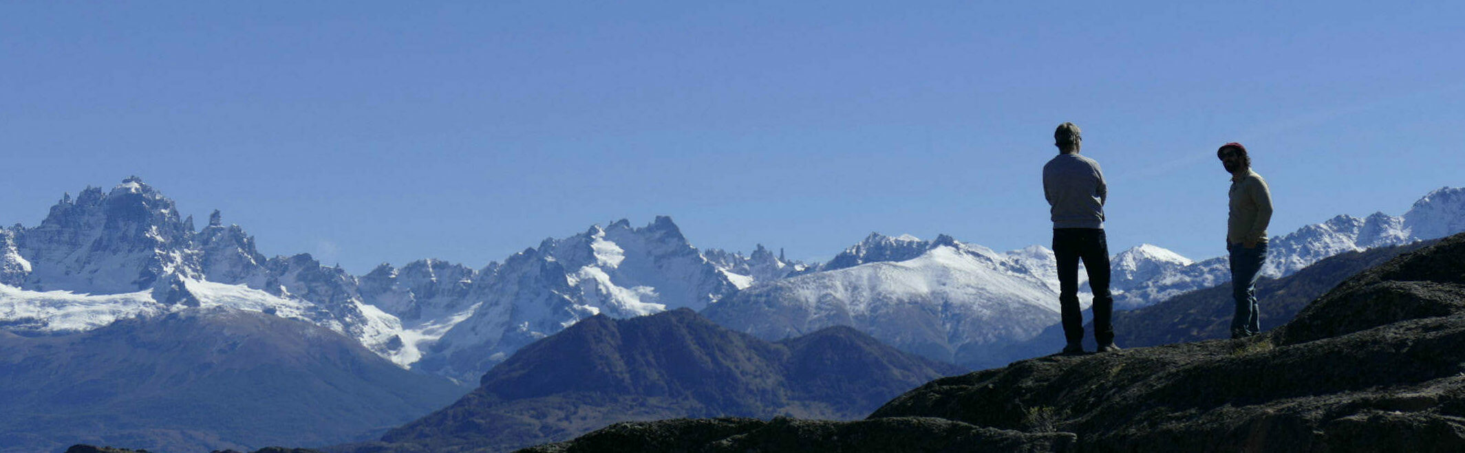 Chile patagonia aysen cerro castillo two people in silhouette with mountains behind