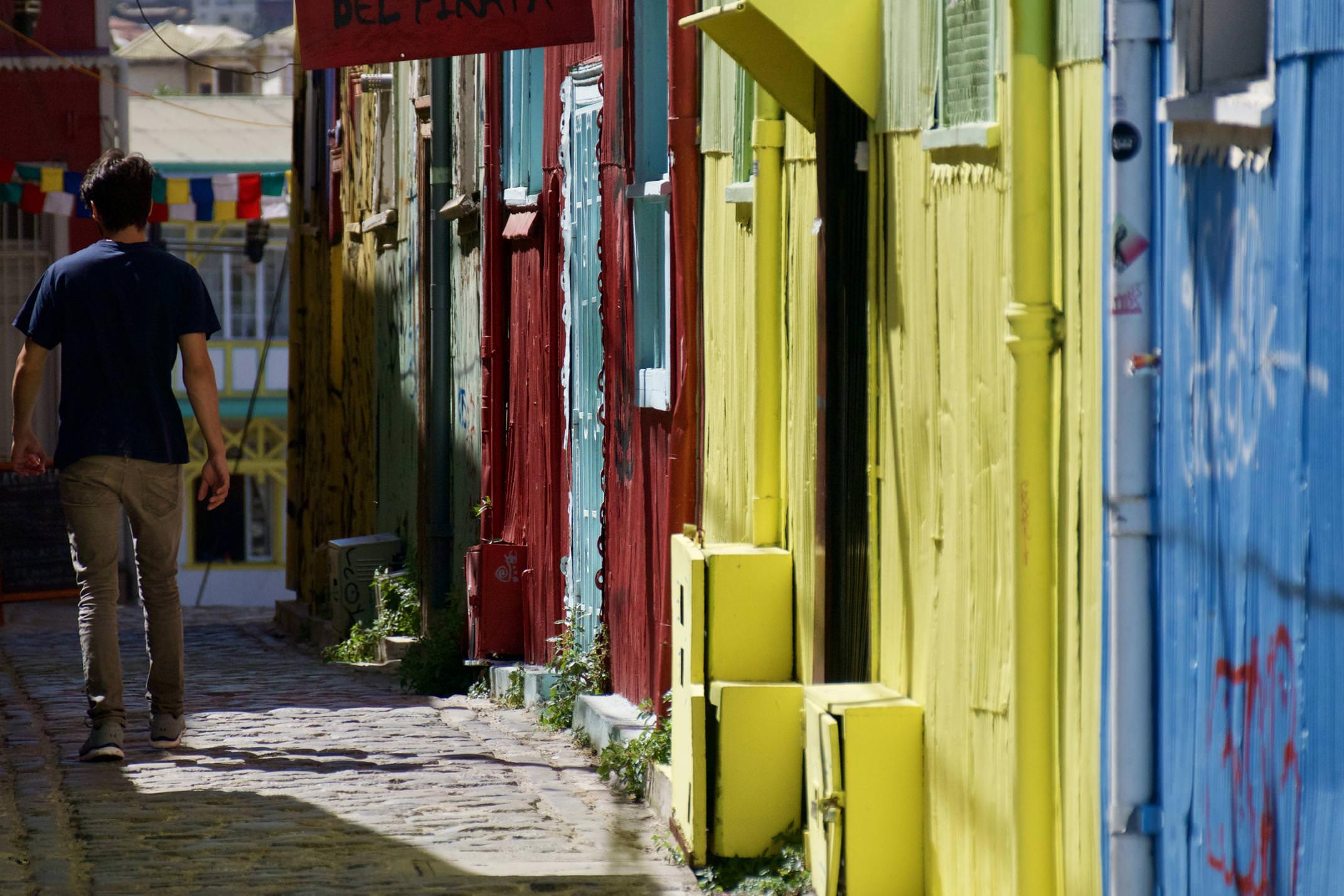 Chile valparaiso colourful street man walking