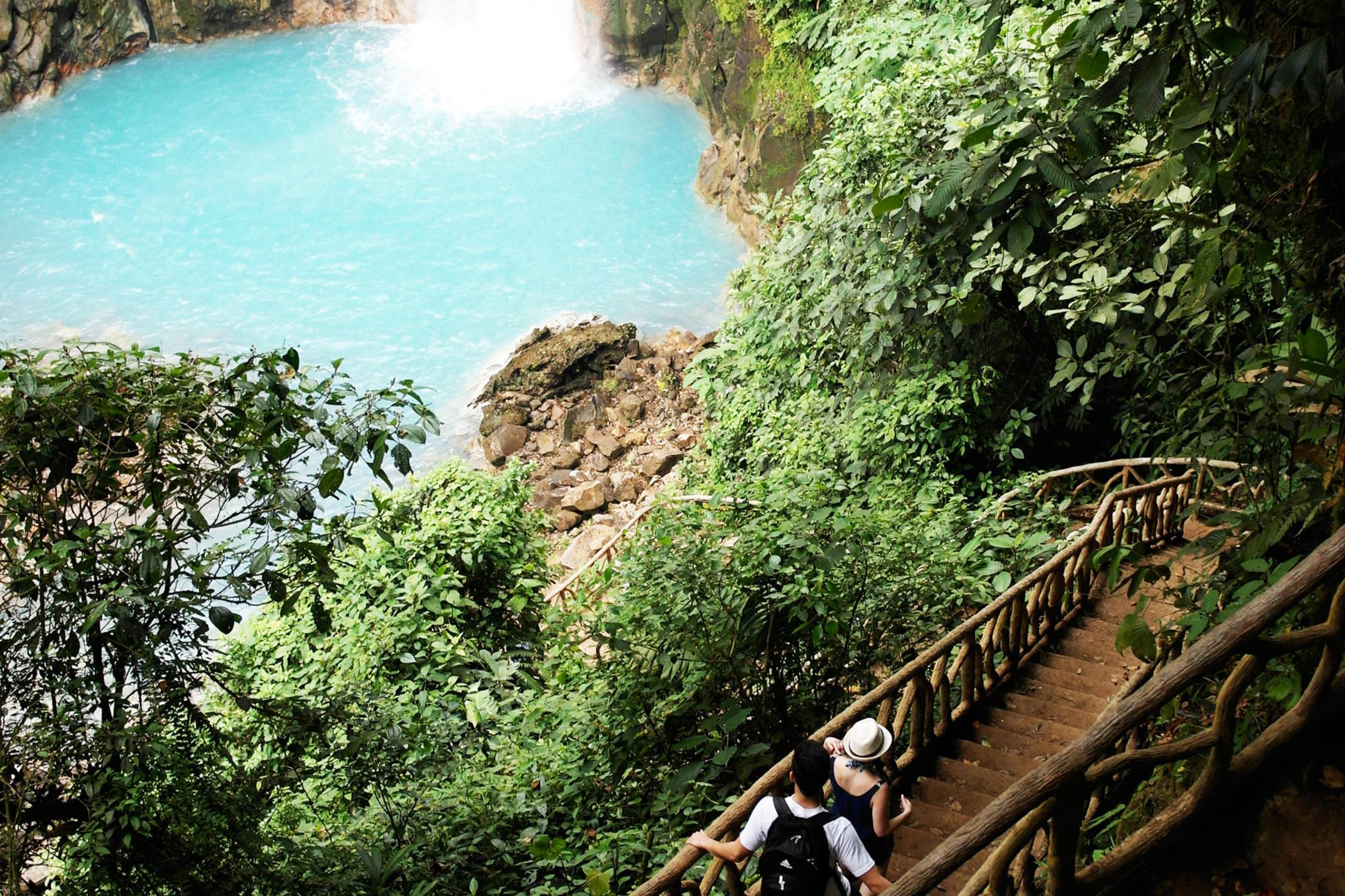 Costa rica tenorio volcano national park walking down to rio celeste waterfall