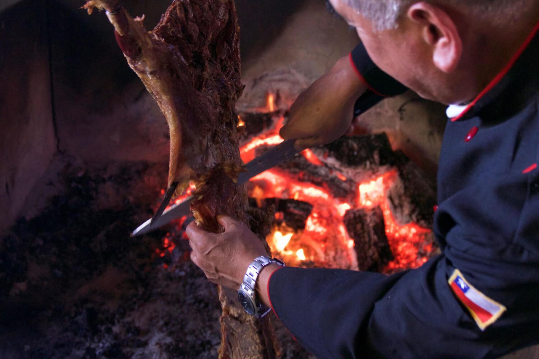 Enjoying a traditional asado in Chilean Patagonia