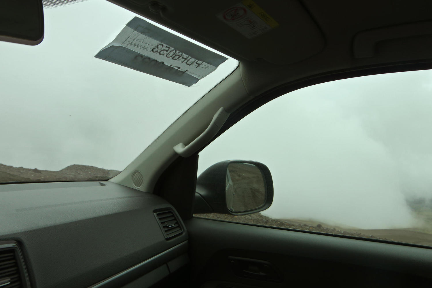 Driving through the clouds on Cotopaxi volcano