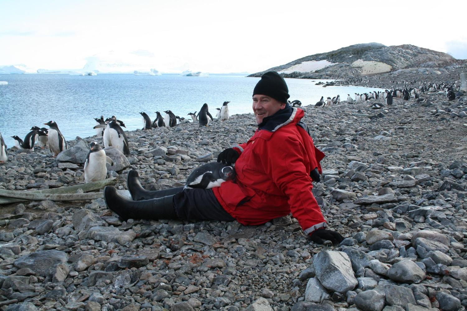 antarctica-antarctic-peninsula-man-with-penguin-on-lap