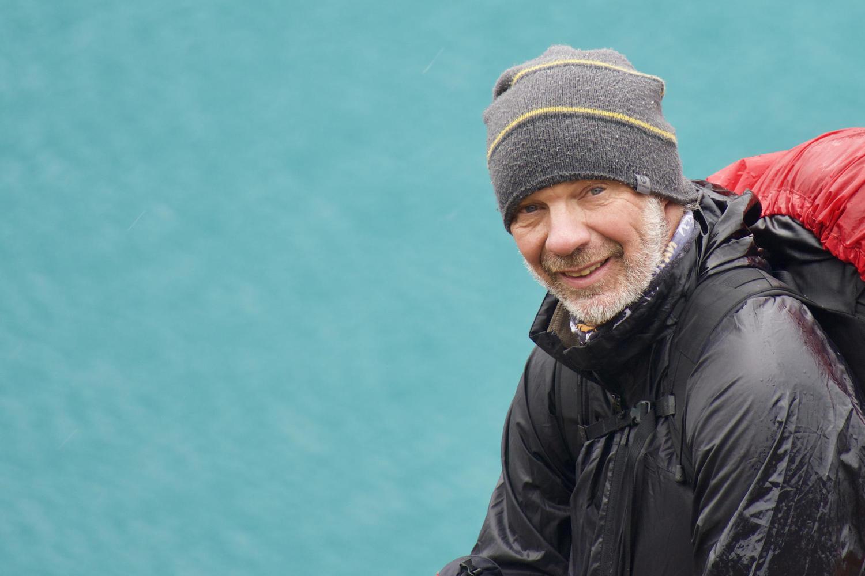Pura guide Camilo Silva in front of the Cerro Castillo Lagoon