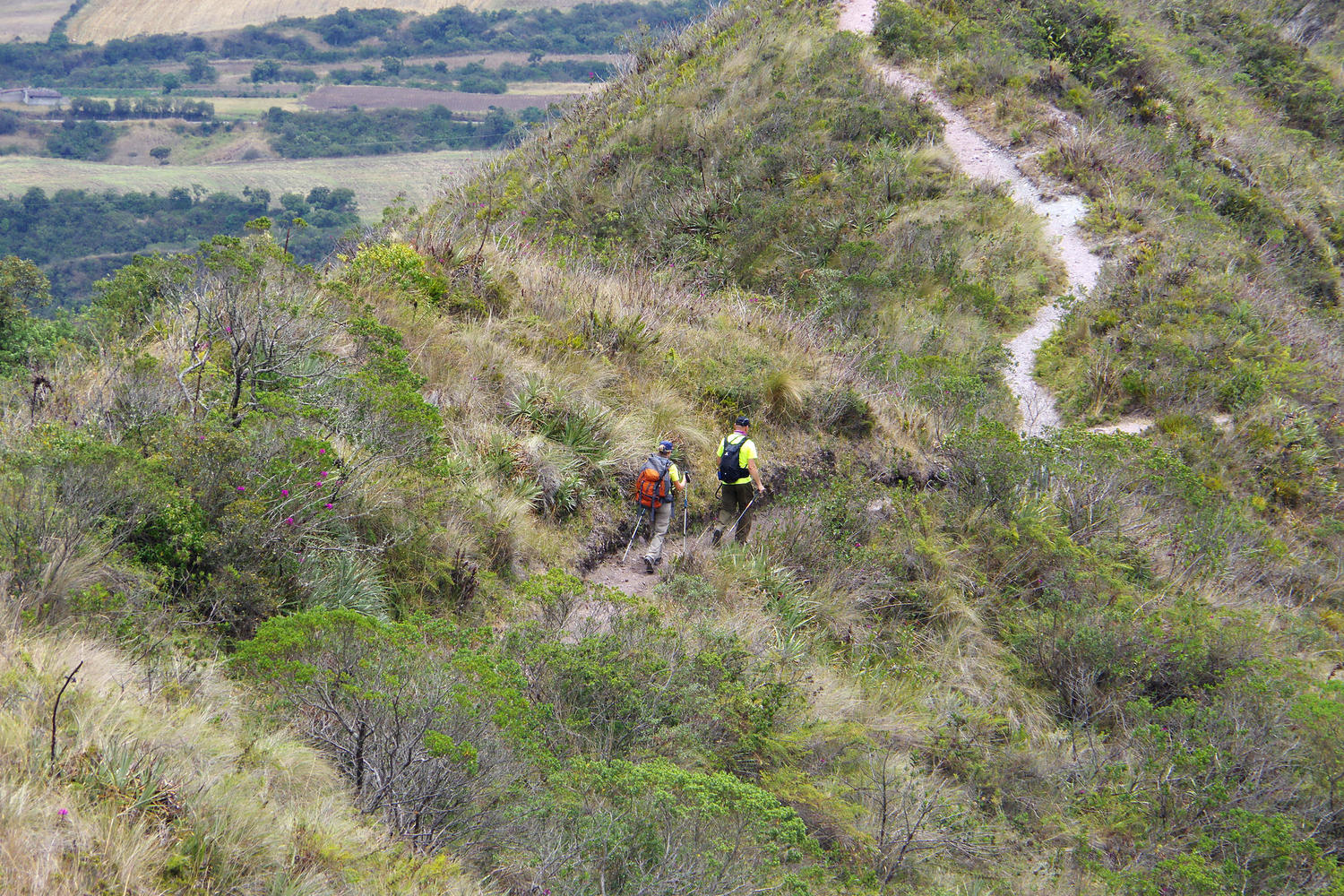 Walkers following the trail around the rim of Laguna de Cuicocha