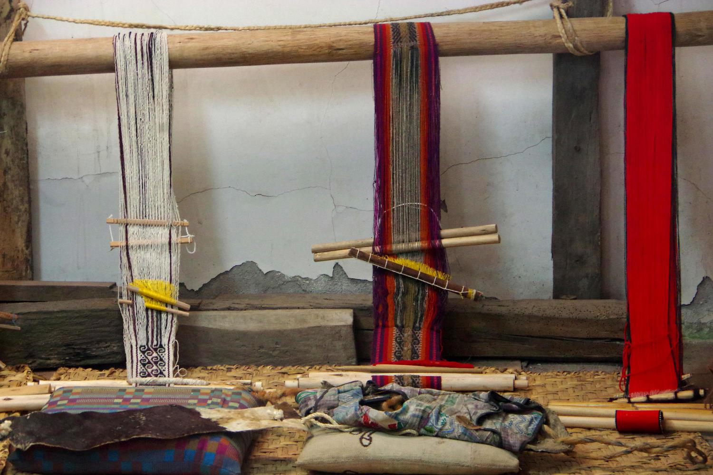 Unfinished weavings in the Tahuantinsuyo weaving workshop near Otavalo