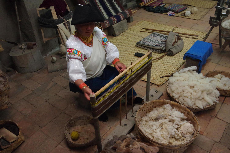 Luz-María warping alpaca wool in the weaving workshop