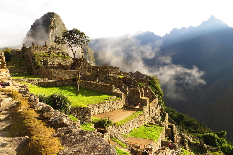 Machu Picchu bathed in golden sunlight