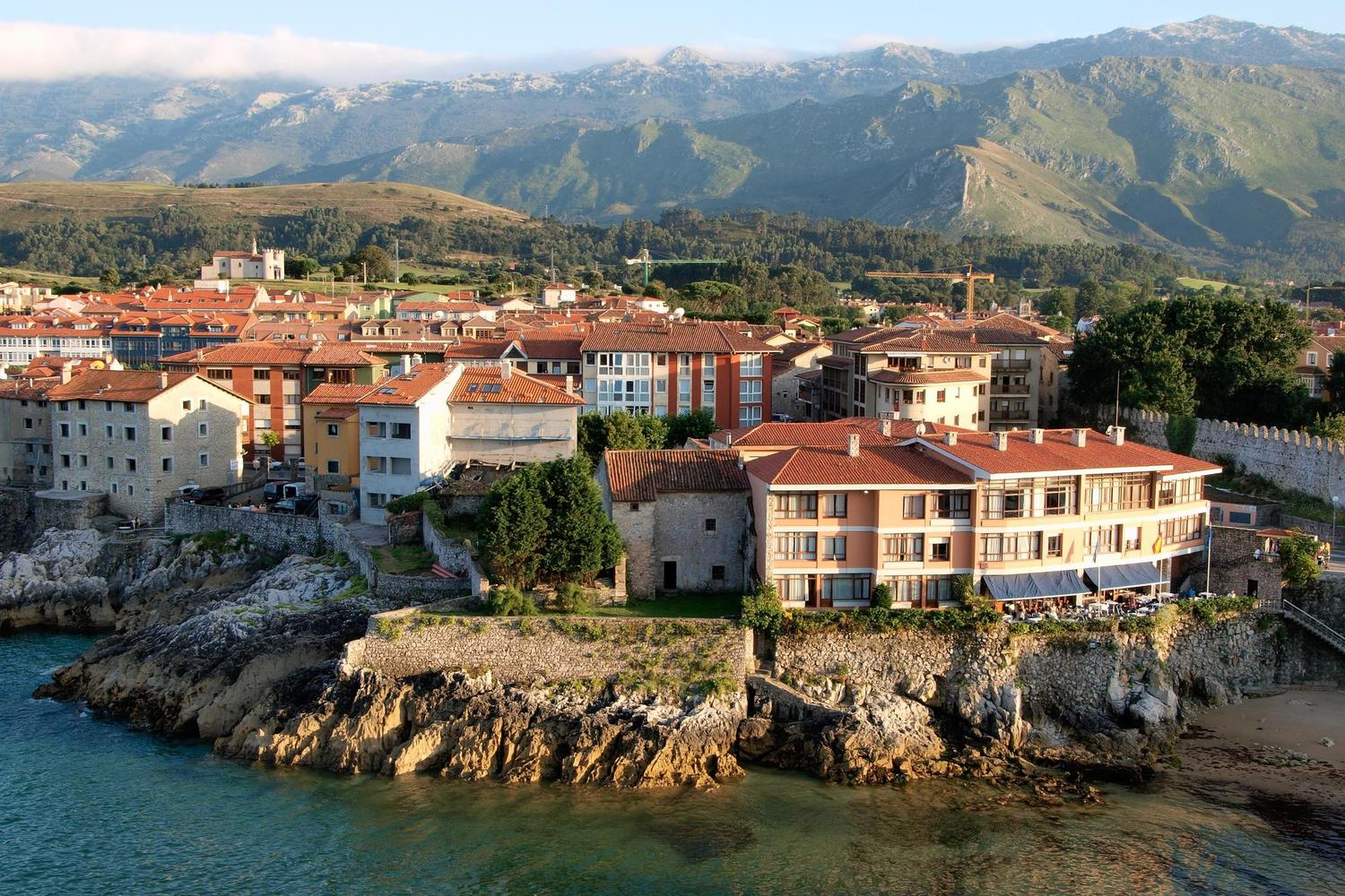 The pretty waterfront of Llanes with the Picos mountains behind