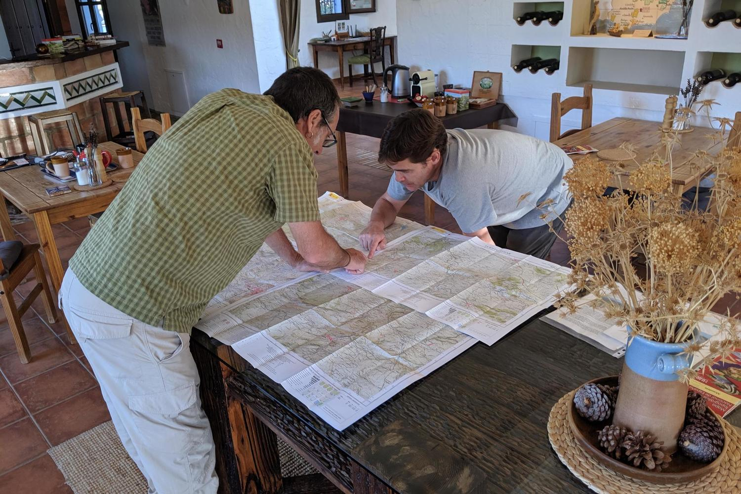 Xabi and Tim poring over the maps