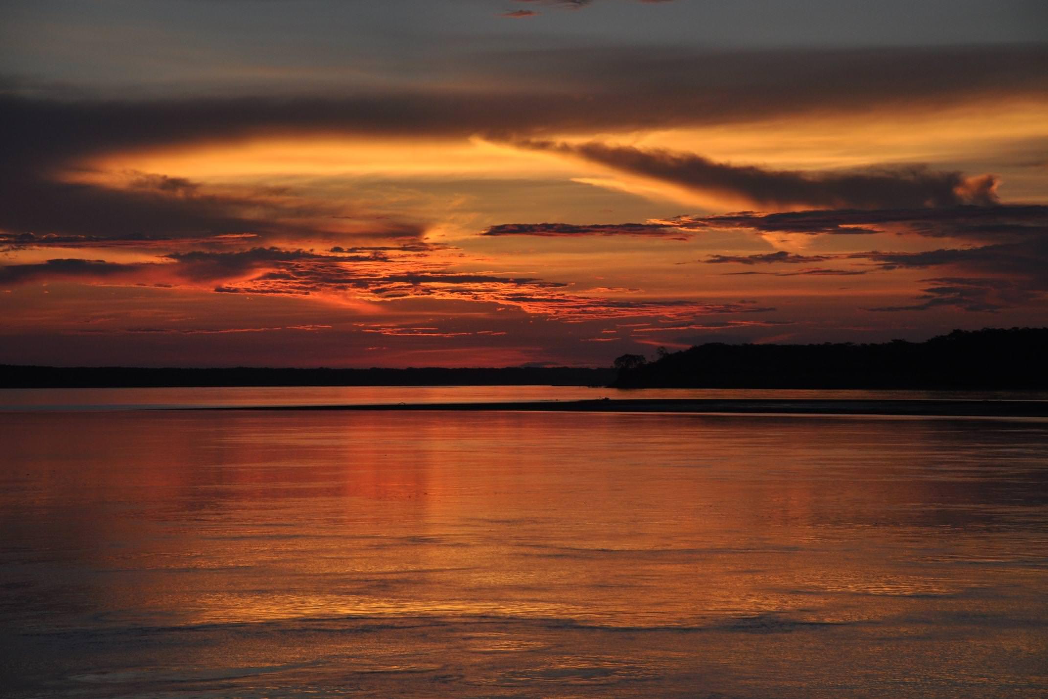 Peru amazon sunset over river