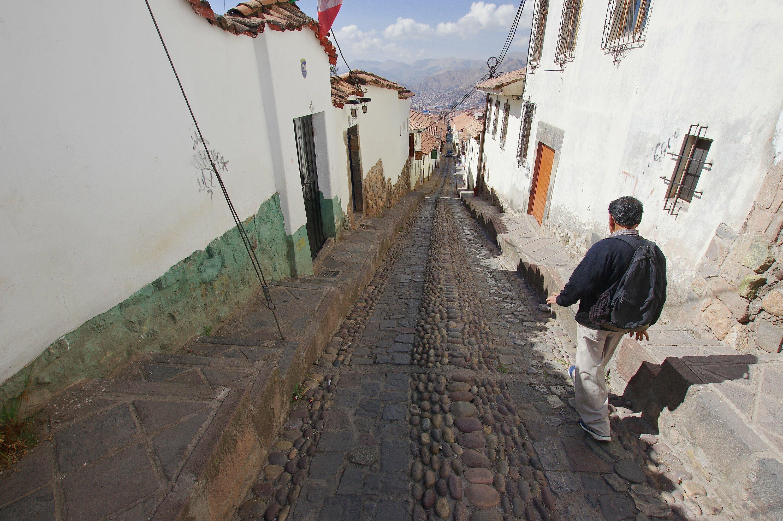 Peru cusco walking backstreet in san cristobal c chris bladon