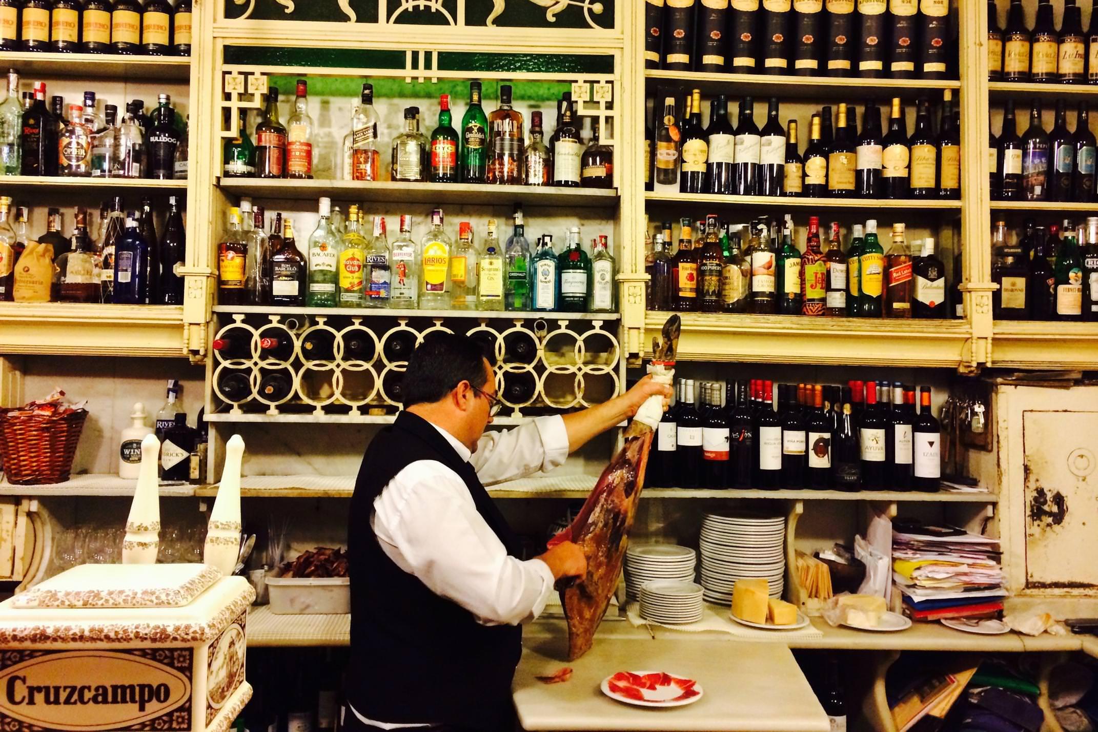 Spain andalucia seville tapas ham carving in rinconcillo
