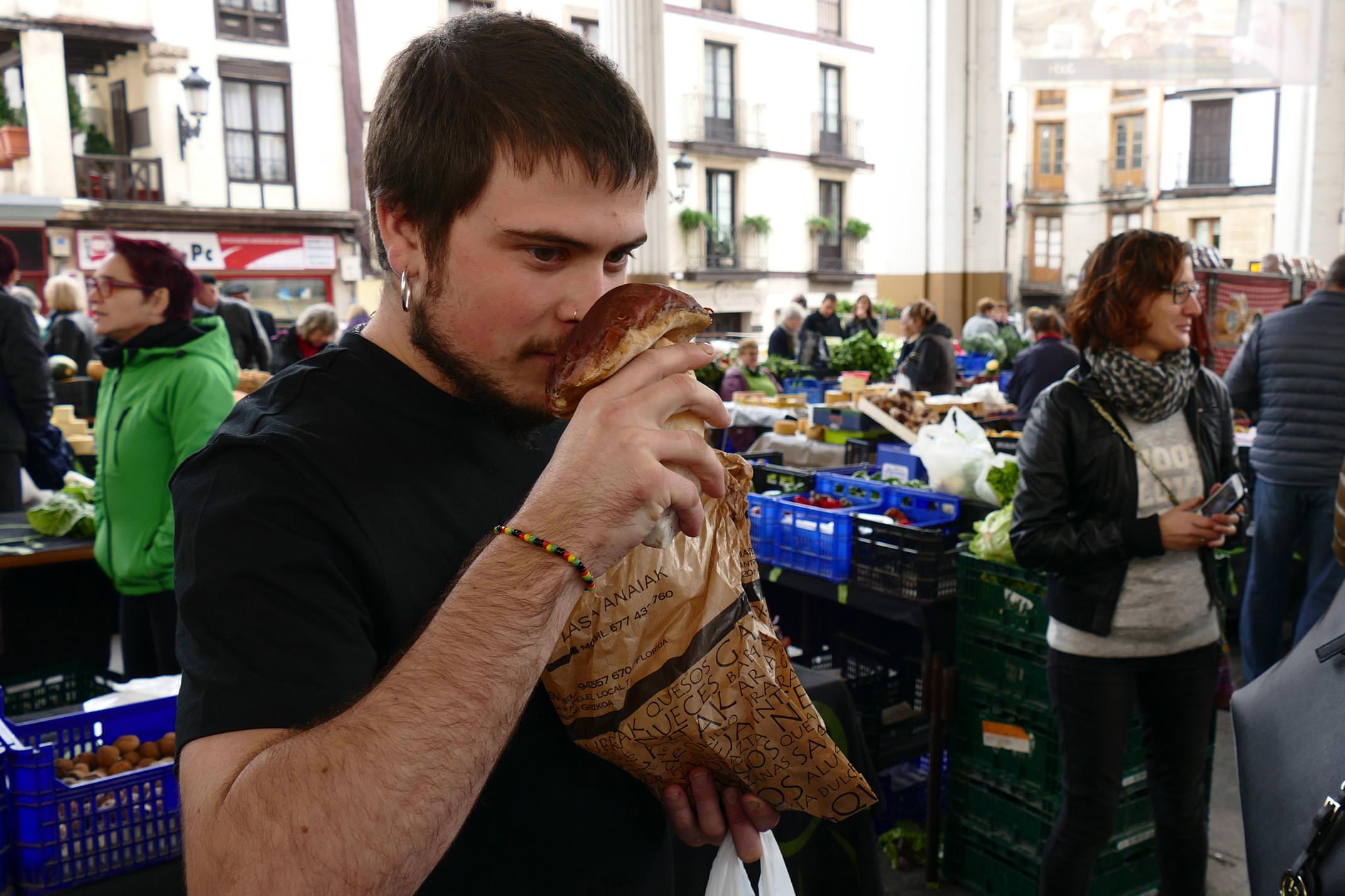 Spain basque country ordizia market chef smelling boletus mushroom