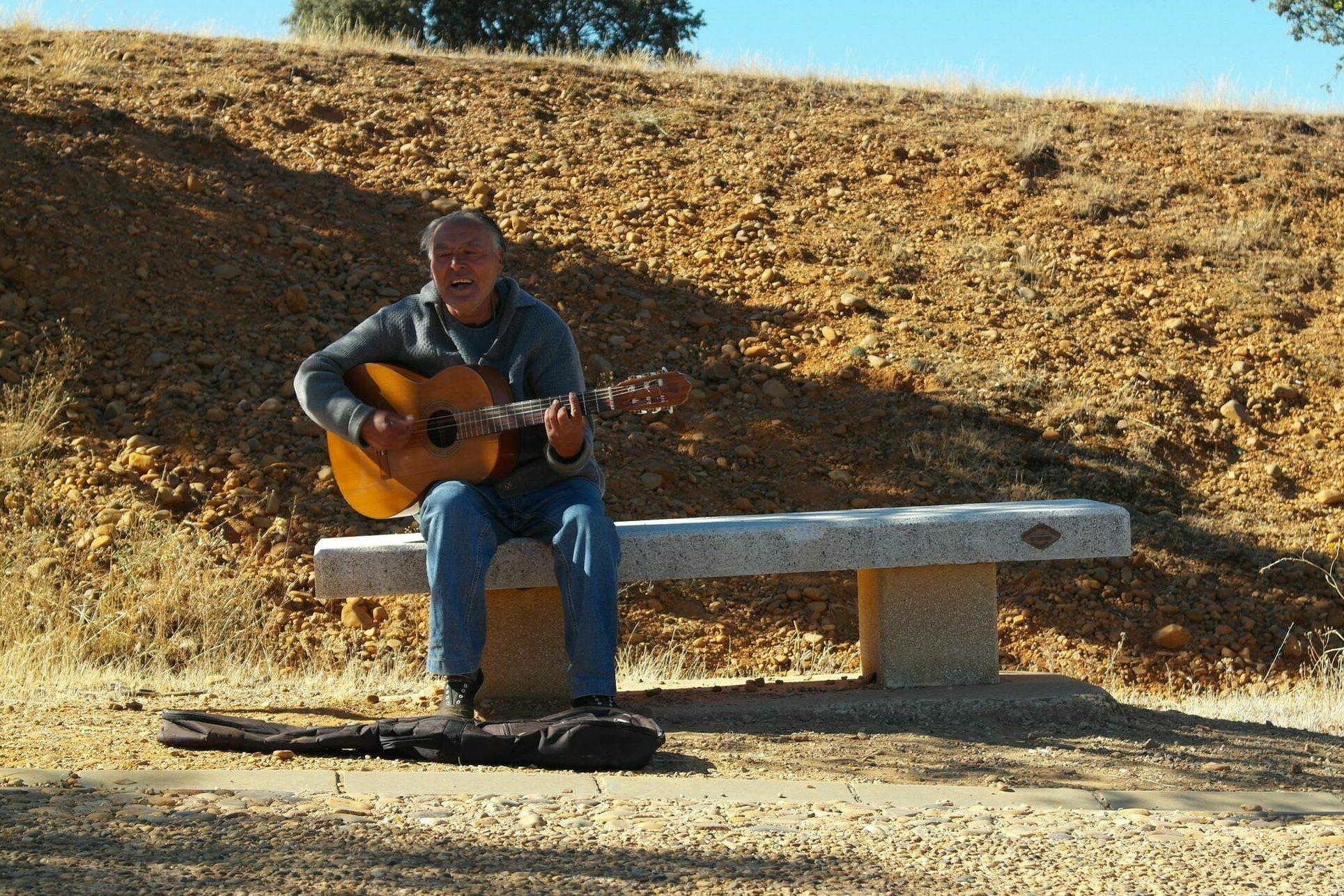Spain camino de santiago guitar player astorga