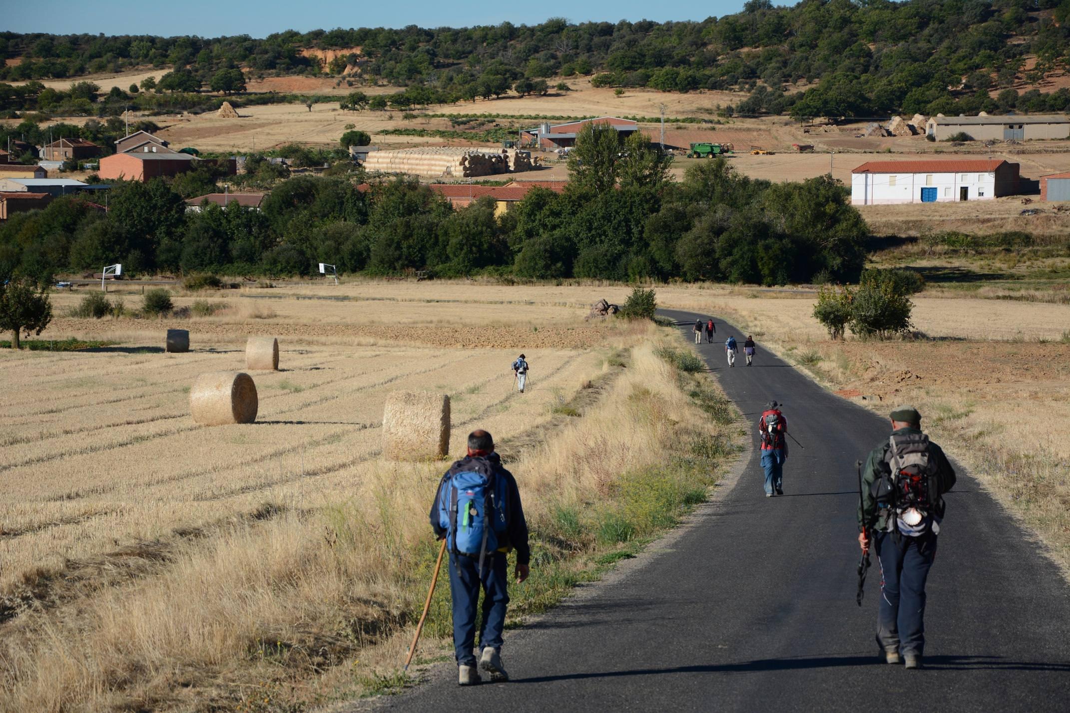Spain camino de santiago pilgrims on road