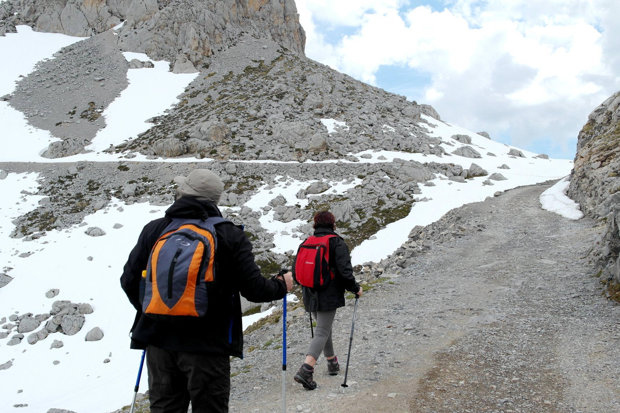 Spain picos de europa walking couple on path fuente de