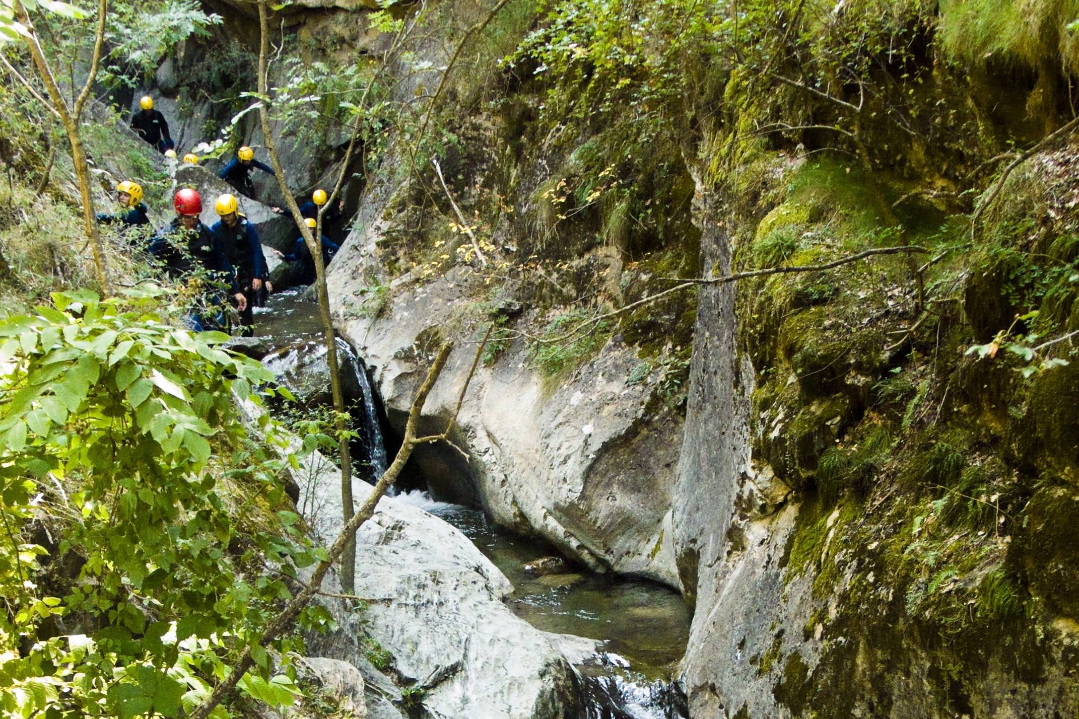 Spain pyrenees aigues tortes canyoning in narrow gorge