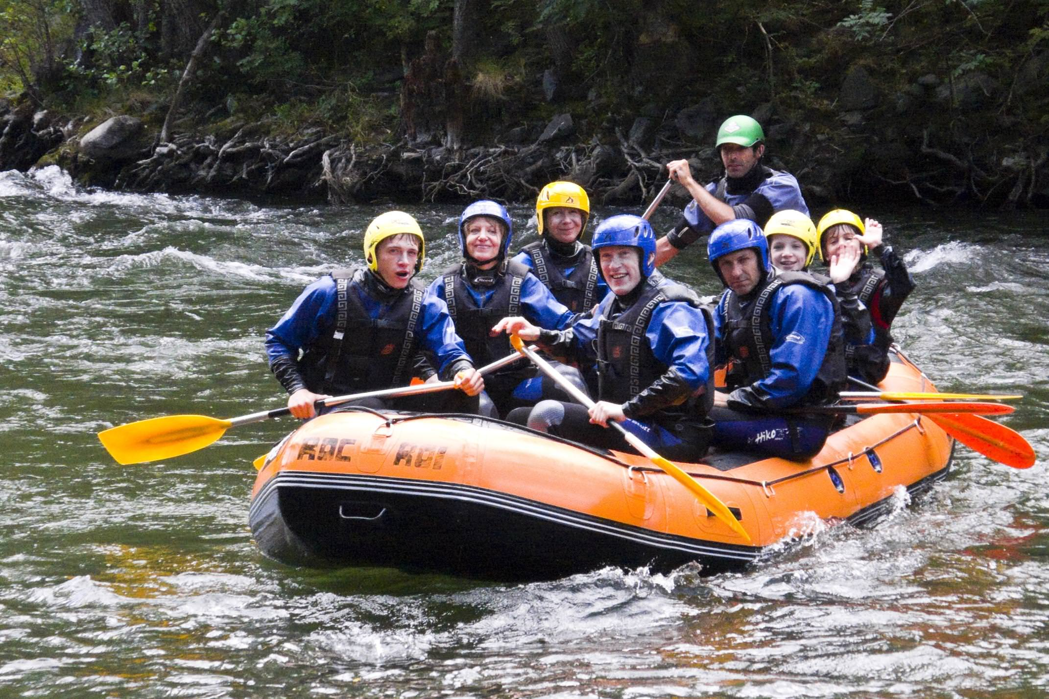 Spain pyrenees aigues tortes rafting family group close up